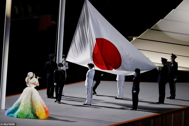The Japanese flag is raised over the main Olympic stadium in Tokyo during the opening ceremony