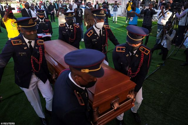 Pallbearers in military attire carry the coffin holding the body of late Haitian President Jovenel Moise after he was shot dead at his home in Port-au-Prince