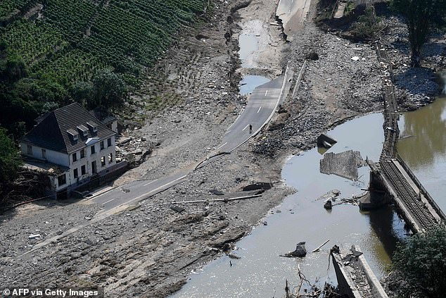 Pictured: A destroyed railway track, building and highway are visible between Rech and MAyschoss in Ahrweiler, Germany on Friday following devastating flooding