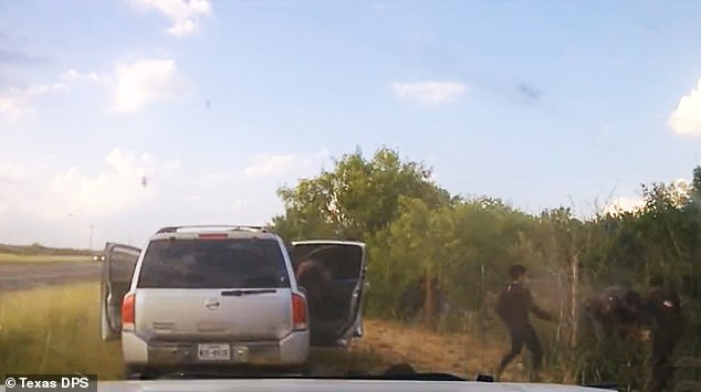 The smuggler can be seen as he bails, and at least a dozen illegal immigrants spill out and flee. Trooper focused on driver & caught him. Some of the passengers got away