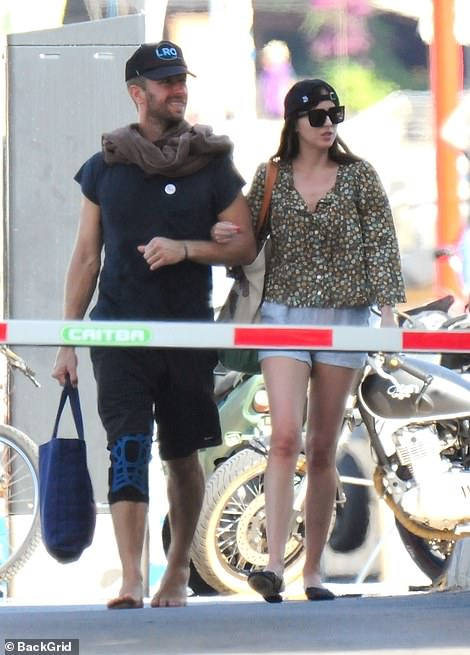Soaking it up! Dakota Johnson jetted for a romantic getaway with her boyfriend Chris Martin to Palma, Mallorca, where they were spotted taking a boat ride and soaking up the local sights