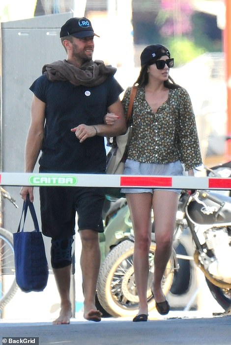 Coupled up: The couple were seen putting on a rare public display of affection as they linked arms while walking around the Spanish town