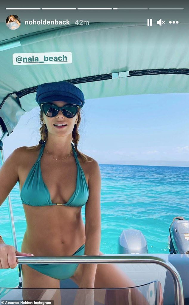 Holiday: The Heart FM presenter then set sail as she climbed aboard a boat and slipped into a turquoise bikini