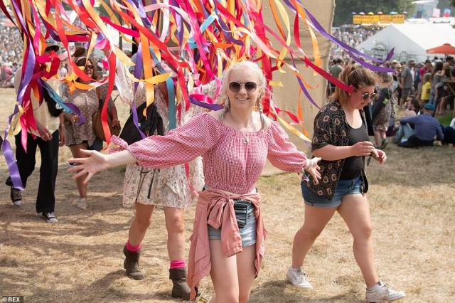 Festival goers grinned as they enjoyed the freedom of pre-pandemic conditions, crowding together and not wearing masks