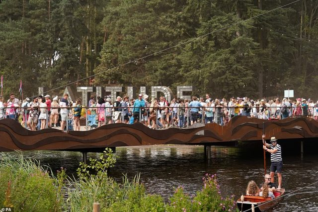 Festival goers pictured lining up at Latitude Festival in Henham Park, Southwold, Suffolk, this afternoon