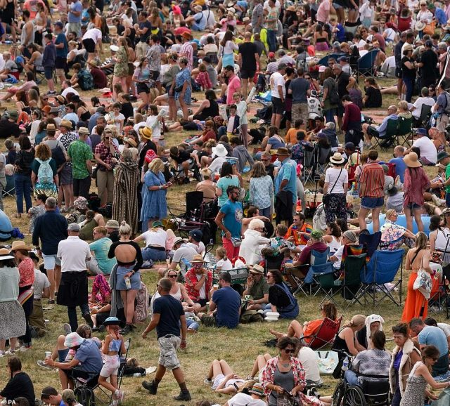 Crowds of festival goers watch performances at the Obelisk Arena at Latitude festival in Henham Park, Southwold, Suffolk