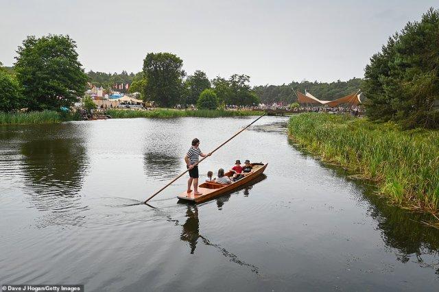 Festivalgoers enjoy a punt at Henham Park, Southwold, on the fourth day of Latitude festival on Saturday
