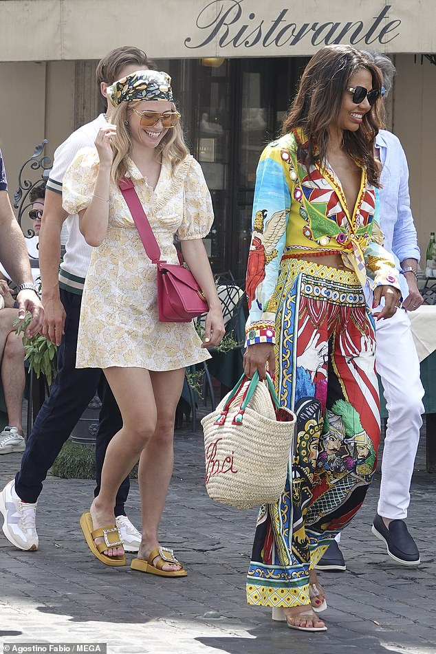 Pixie Lott (left) and Emma Thynn, Marchioness of Bath, step out for lunch at Restaurant Rosati in Rome