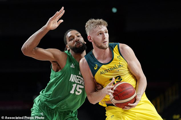 Australia's Jock Landale passes ahead of Nigeria's Jahlil Okafor, left, during a men's basketball preliminary round game at the 2020 Summer Olympics on Sunday