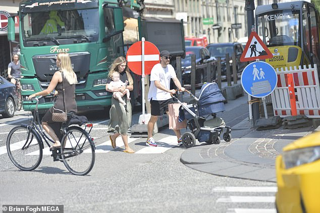 The couple meandered along the pavement having done some light shopping in a positive sign that Eriksen is on the road to recovery