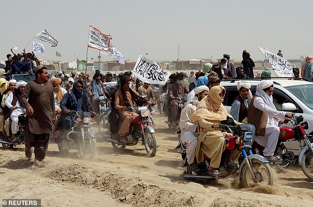 The Taliban's ongoing assault has seen the insurgents capture half of Afghanistan's districts and border crossings (pictured, Taliban fighters capture the Pakistan-Afghanistan border crossing at Chaman on July 14) as well as encircle several provincial capitals, with most of the fighting in the countryside