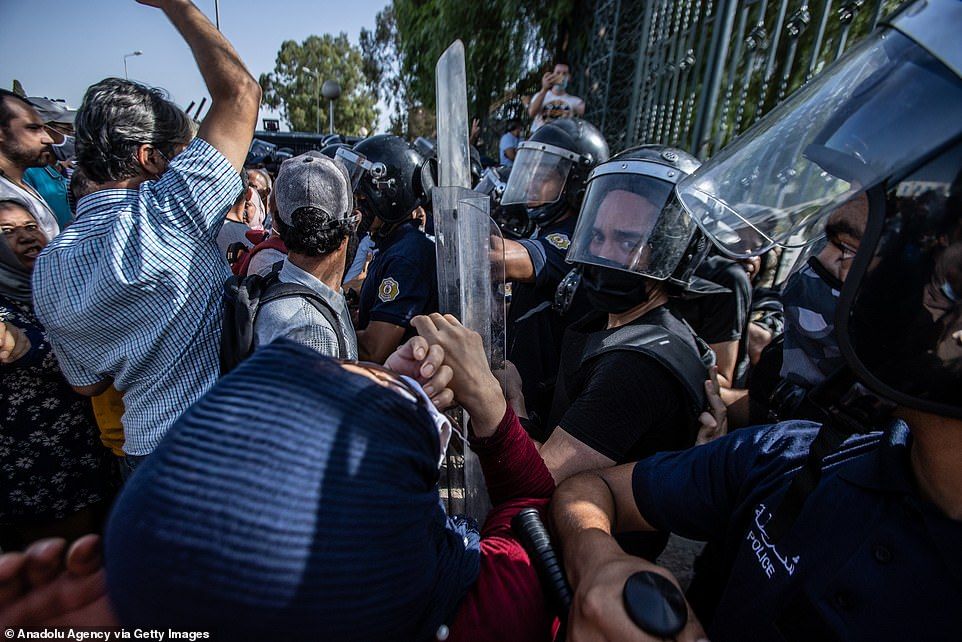 Soldiers from early Monday blockaded the assembly in Tunis and parliament speaker Rached Ghannouchi, who said he would call a session in defiance of the president, was blocked from entering by the army