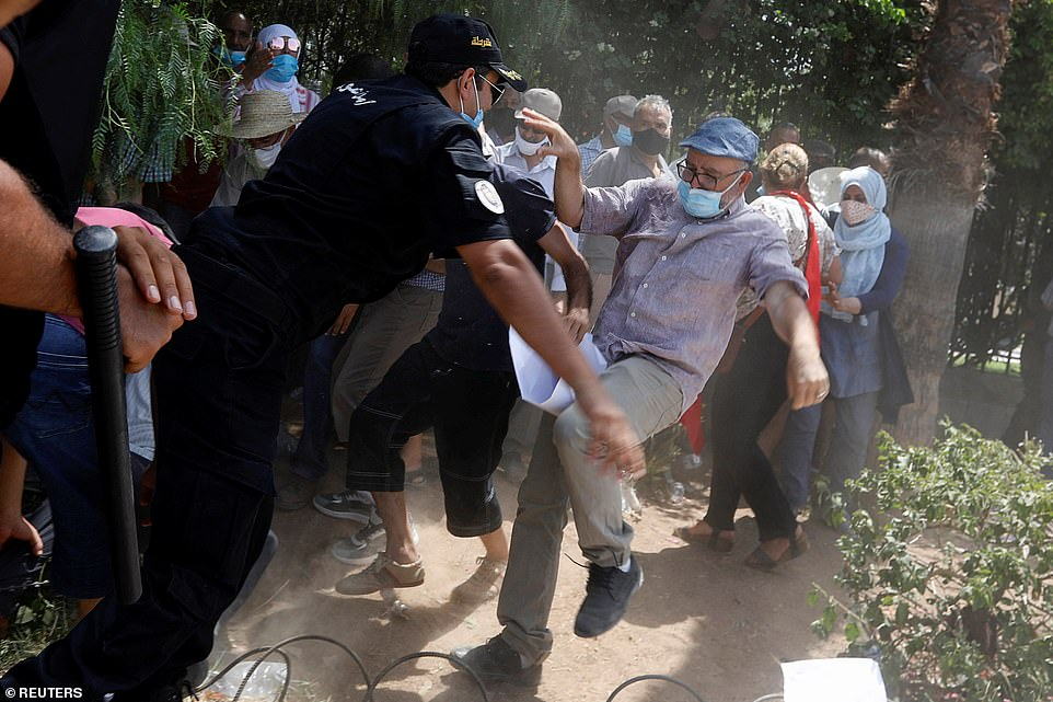 Protesters scuffled with police and rival political supporters during a demonstration outside the parliament building in Tunis on Monday after the prime minister was sacked and the parliament suspended