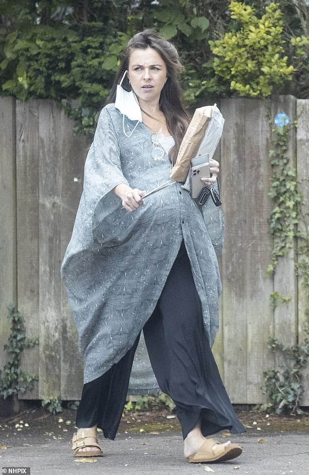 Out and about:She is expecting her first child in September. Yet Louisa Lytton showed no signs of slowing down as she was out running errands in north London on Monday