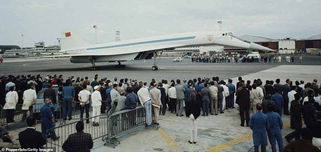 Tu-144 continued to fly cargo routes until it was finally grounded in 1983. Above: Observers look at the plane during a press event