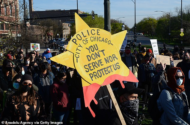 The petition, which has garnered 1,038 of its 1,600-signature goal, argues that ShotSpotter should be ousted in favor of more transparent crime-prevention measures like community-orientated policing Above, protestors were in the streets of Chicago following Toledo's killing
