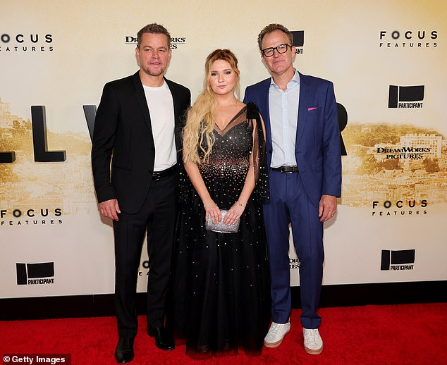 Trio of the evening:Abigail and Matt also made sure to smile for the cameras alongside the director of Stillwater, Tom McCarthy (R)