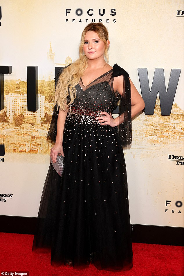 Little Miss Who?Breslin, 25, looked incredible in a partially sheer black evening gown, adorned with silver sparkles and a beautiful bow detail at the shoulder