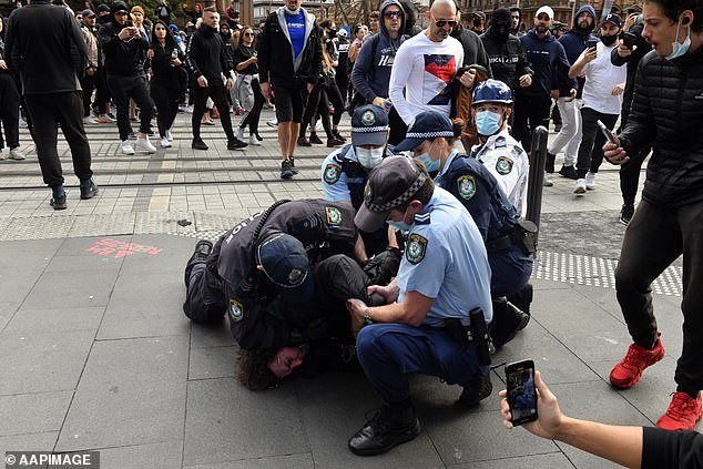 Clash:It comes after tens of thousands of enraged Australians took to city streets to protest against Covid restrictions on Saturday