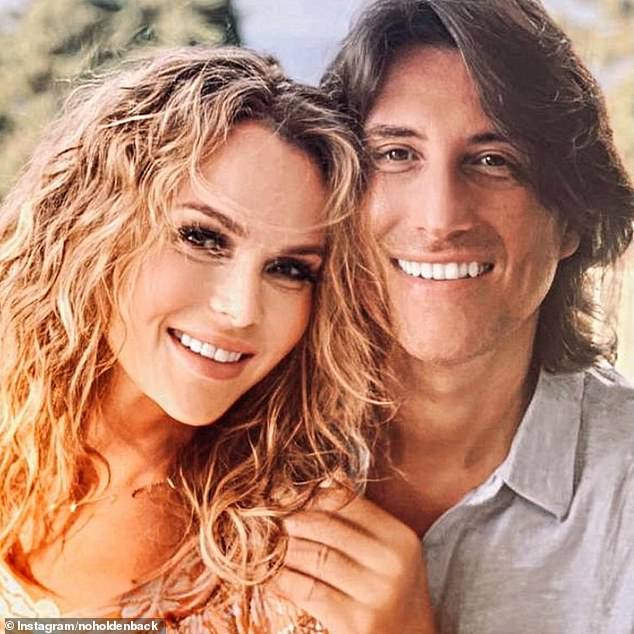 Gorgeous:Amanda Holden showed off her natural curly hair in a rare snap as she enjoyed a holiday date with husband Chris Hughes on Monday
