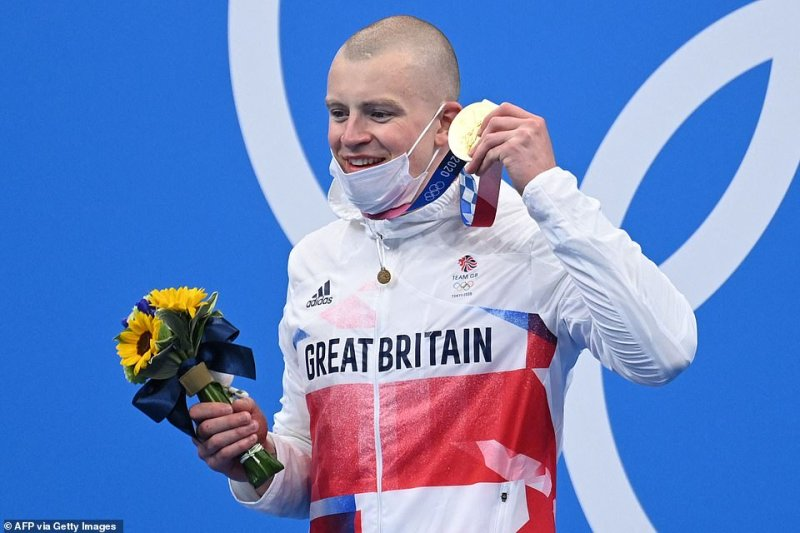 Briton Peaty held his medal aloft and beamed during the medal ceremony after his triumph