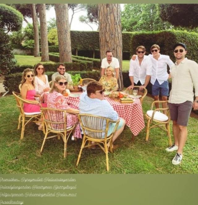 Garden lunch: Eliza Spencer and her boyfriendChanning Millerd (centre, in yellow) joined close family including half-brother Samuel Aitken (second from right) and Lady Amelia and her fiancéGreg Mallett (third from left) for an outdoor lunch on Monday