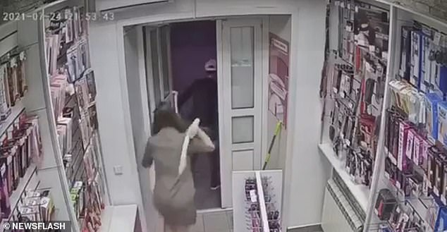 Despite the dangerous situation, the woman seems calm after the 'robber' disappears and apparently does not lock the door behind her