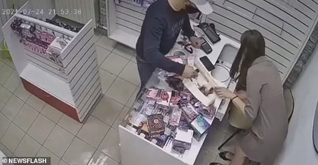 In CCTV footage from a sex store in Novokuznetsk in Kemerovo Oblast on July 24, a saleswoman can be seen working late when a 'masked thief' entered the store and brandished a small knife