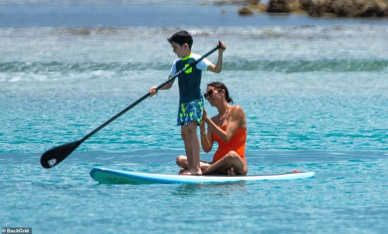 Stable: He proceeded to join his mother on the paddleboard