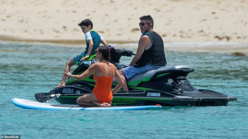 Finished: Eric was seen dismounting from the jet ski