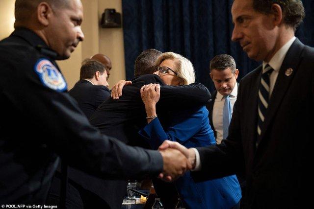 Rep. Liz Cheney hugs Michael Fanone, officer for the Metropolitan Police Department