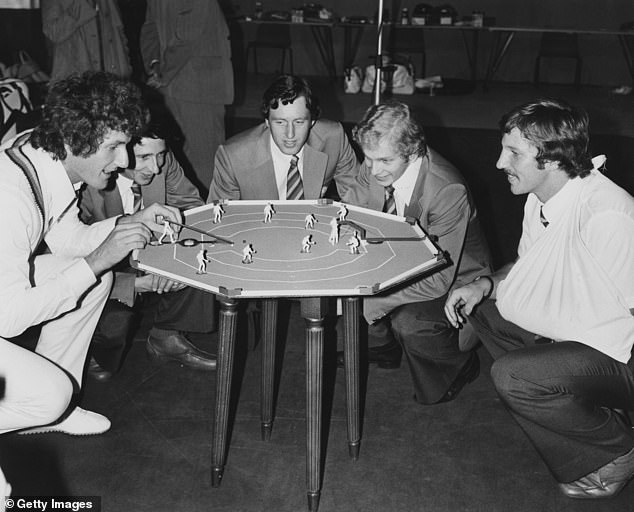 Hendrick (centre) engrossed in a game of table cricket with England colleagues Bob Willis (left), Derek Randall (second left), David Gower (second right) and Ian Botham (right) before flying to Australia in 1978