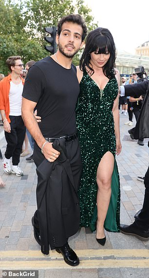 Stepping out: Daisy flaunted her frame in the floor-length dress and accentuated her toned legs with a pair of pointy black stilettos