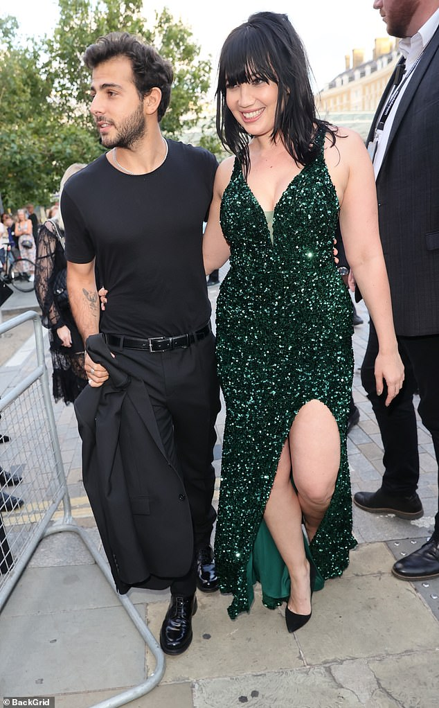Couple goals: The model was joined by her boyfriend Jordan Saul as she put on a leggy display at the star studded bash in the sequin thigh-split cocktail dress
