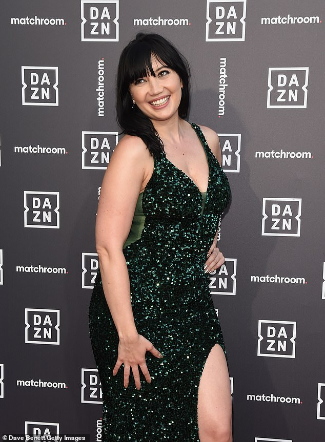 Wow: Daisy Lowe oozed glamour when she attended the Dazn x Matchroom VIP launch event in a plunging emerald gown in London on Tuesday night