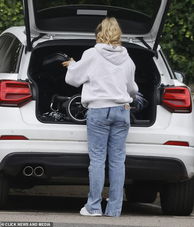 Unloading: the former Love Island star gradually took the buggy out of the trunk of his car before assembling it