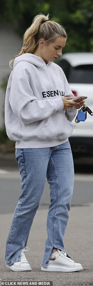 Comfort: Dani went for comfort when she stepped out in Essex and looked radiant without even a stain of makeup