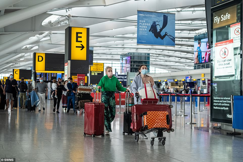 The move, which could leave hundreds of thousands of Britons having to self-isolate unexpectedly on return, is believed to be on the cards amid growing concern about cases of the South African variant. Pictured: Heathrow today