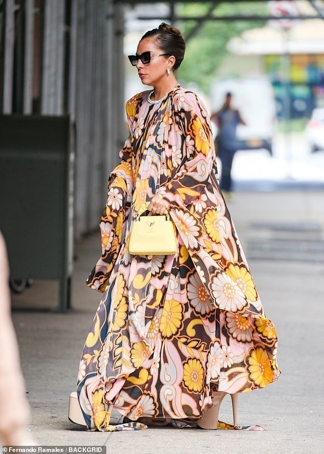 Chic in the city: The 35-year-old singer draped her figure in a silk dress before her next big concert: a performance duet with Tony Bennett to celebrate his 95th birthday