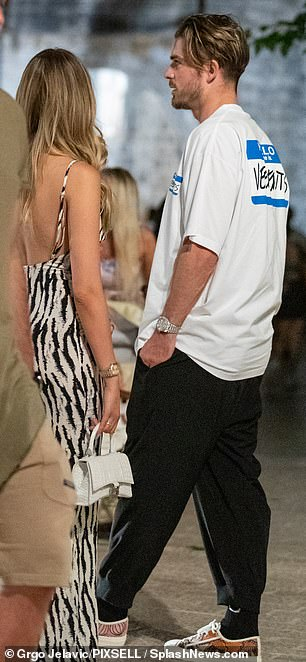 Easy breezy: The footballer wore black sweatpants and an oversized white t-shirt with on-trend sneakers
