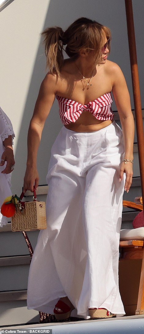 Vacation outfit: Jen, 52, looked gorgeous in a summery white skirt and bikini top