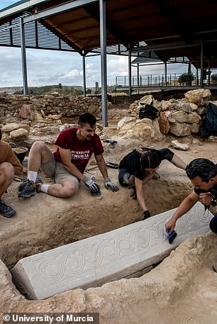 It wasn't until they cleaned the coffin and found aChi Ro, or christogram, at one end that they realized it was a coffin
