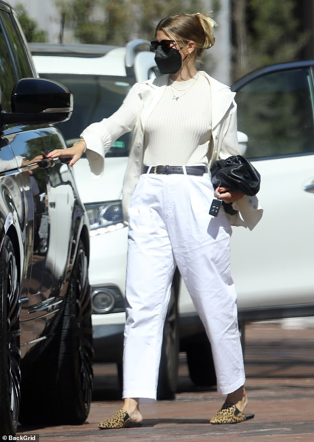 Retail therapy: Sofia Richie, 22, dons a chic all white ensemble while shopping at Neiman Marcus in Beverly Hills