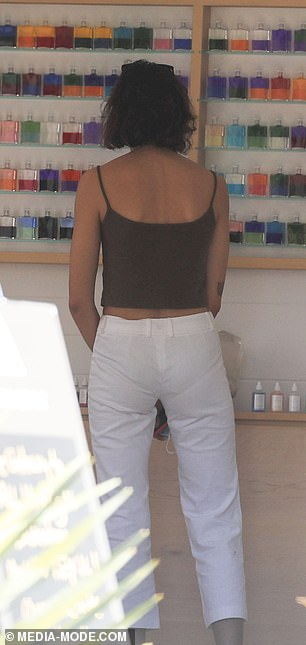 Groovy: She was seen visiting the Aura-Soma store, which advertises itself as