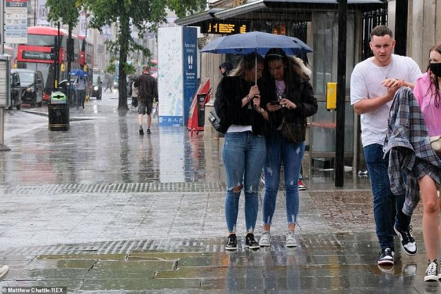 The meteorologist added:'It will clear off the scene quite quickly and through the weekend the wind changes direction. We see our feeds coming in from the north, so temperatures will struggle a little bit' (pictured: showers in London on Wednesday)