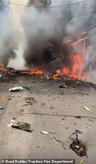 Images of the scene show flaming debris in the immediate aftermath of the crash, which occurred in a populated area
