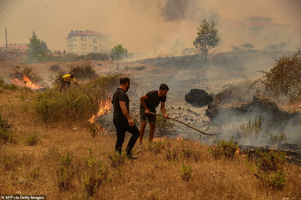 Residents help extinguish forest fires that have killed at least three people and forced hundreds of people to flee their homes