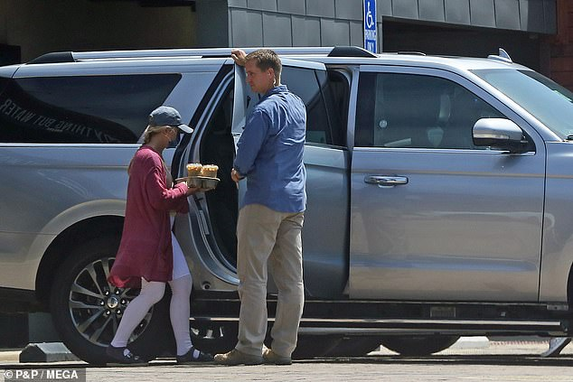 Hunter Biden's wife was seen being escorted by two Secret Service agents in a government Ford Expedition as she stopped for a brew near the couple's new home on Tuesday