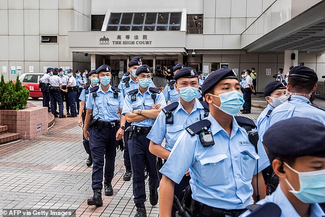 Police gathered outside the High Court on Friday ahead of activist Tong Ying-kit's sentencing after he was convicted under Hong Kong's national security law on Tuesday