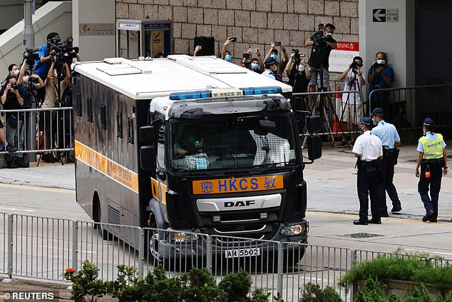 A prison van carrying activist Tong Ying-kit leaves the High Court in Hong Kong on Friday after the 24-year-old was sentenced to nine years in prison